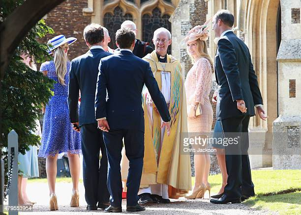 Godparents and guests greet The Archbishop of Canterbury Justin Welby as they arrive at the Church of St Mary Magdalene on the Sandringham Estate for...