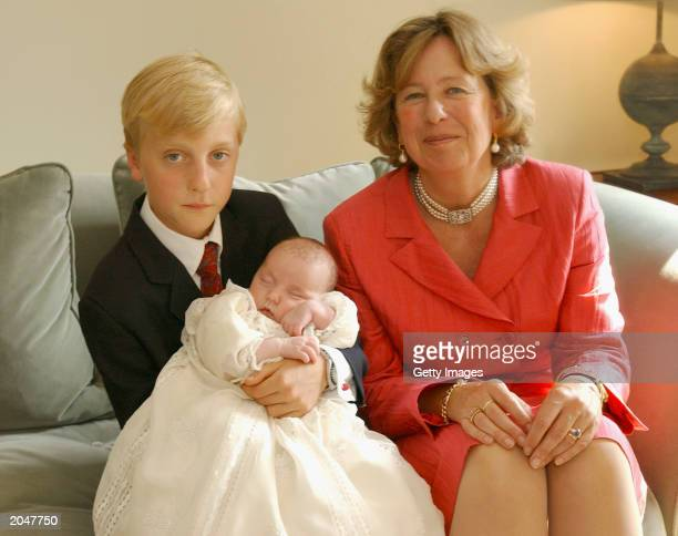 Godparents Prince Joachim and Nora from Lichtenstein sit with little Princess Laetitia Maria June 1 2003 in Brussels Belgium Members of the Belguim...