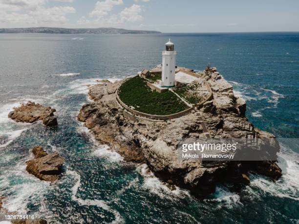 godrevy's lighthouse on the eponymous island in the sunny st ives bay. june 03, 2021 - protection stock pictures, royalty-free photos & images