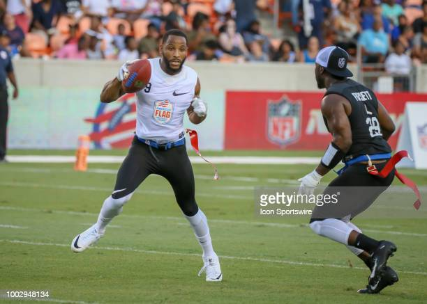 Godspeed cocaptain Justin Foset challenges Fighting Cancer center Robert Myers during the American Flag Football League Ultimate Final game between...
