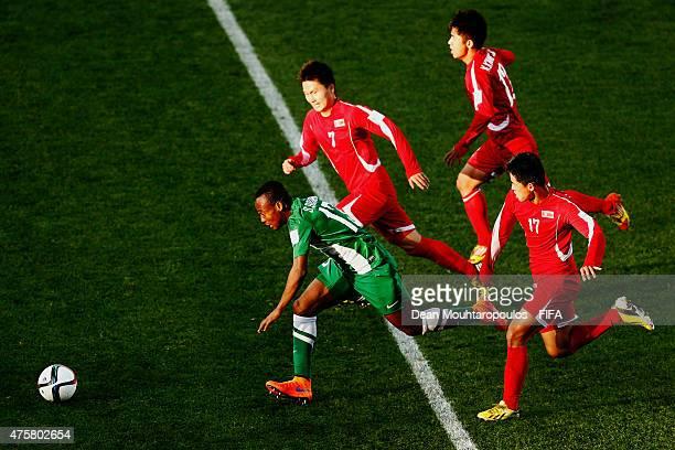 Godwin Saviour of Nigeria gets past Ri Kyong Jin Kim Kwang Jin and Kang Nam Gwon of Korea DPR during the FIFA U20 World Cup New Zealand 2015 Group E...
