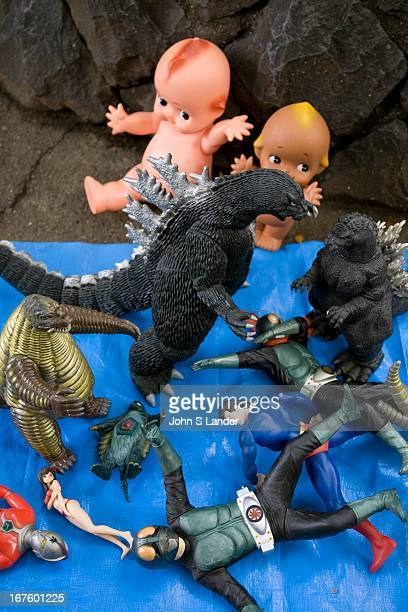 Godzilla action heros and cute kewpie dolls are popular flea market items especially among Asian tourists and Japanese buyers at the Tokyo Sunday...