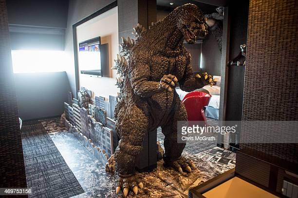 Godzilla replica is seen in the Godzilla themed room of the Hotel Gracery Shinjuku on April 15 2015 in Tokyo Japan The Godzilla replica based on the...