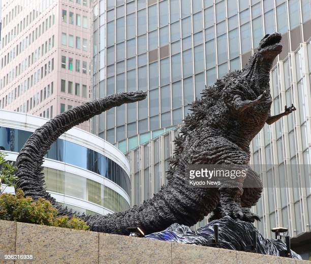 A Godzilla statue is unveiled at a shopping mall in Tokyo on March 22 2018 Measuring 3 meters in height it is the largest Godzilla statue in Japan...