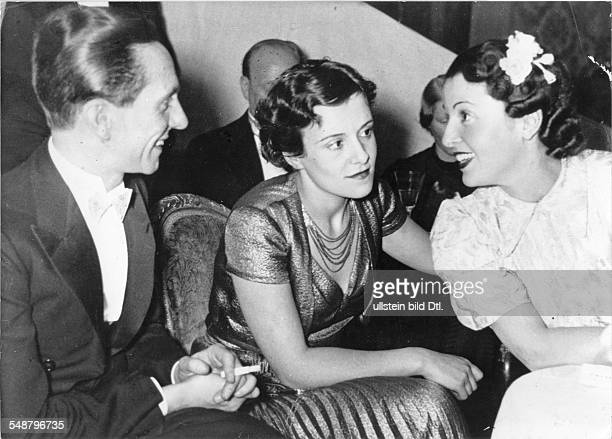 Goebbels Joseph Politician NSDAP Germany *29101897 in conversation with the actresses Erika Dannhof and Jenny Jugo on the Presseball in Berlin...