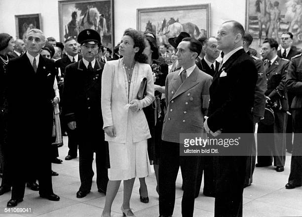 Goebbels Joseph Politician NSDAP Germany *29101897 visiting the 'Grosse Deutsche Kunstausstellung' at the Haus der Deutschen Kunst in Munich next to...