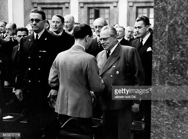 Goebbels Joseph Politician NSDAP Germany *29101897 welcoming the photographer Heinrich Hoffmann at 'Haus der Deutschen Kunst' in Munich during...