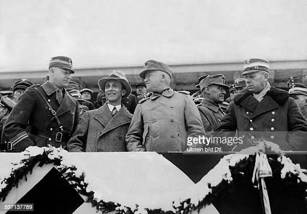 Goebbels Joseph PolitikerNSDAP D als Zuschauer bei den Skimeisterschaften in GarmischPartenkirchen neben Goebbels links SAStabschef Viktor Lutze ganz...