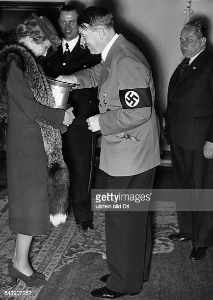 Goebbels Magda Wife of J Goebbels Germany*Adolf Hitler and Magda Goebbels donating money on the day of national solidarity undated Photographer...