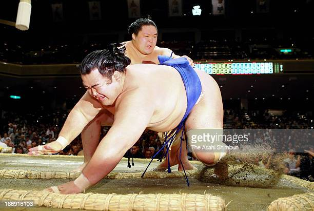 Goeido throws Ozeki Kotoshogiku to win during day five of the Grand Sumo Summer tournament at Ryogoku Kokugikan on May 16 2013 in Tokyo Japan
