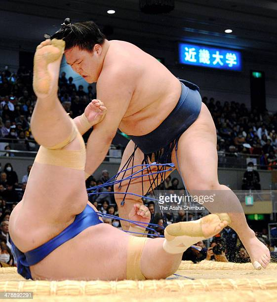 Goeido throws ozeki Kotoshogiku to win during day seven of the Grand Sumo Spring Tournament at Body Maker Colosseum on March 15 2014 in Osaka Japan