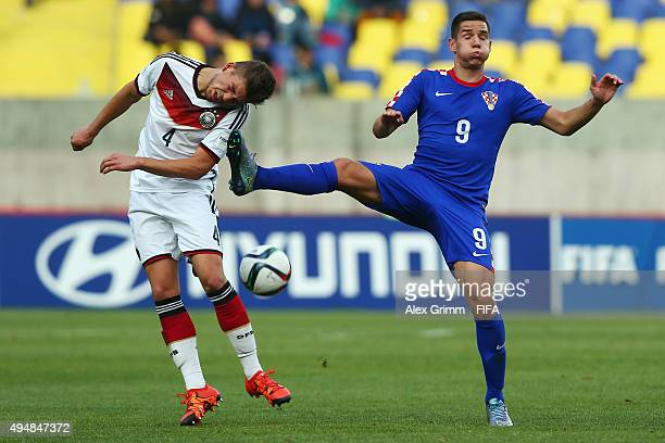 Goekhan Guel of Germany is challenged by Karlo Majic of Croatia during the FIFA U17 World Cup Chile 2015 Round of 16 match between Croatia and...