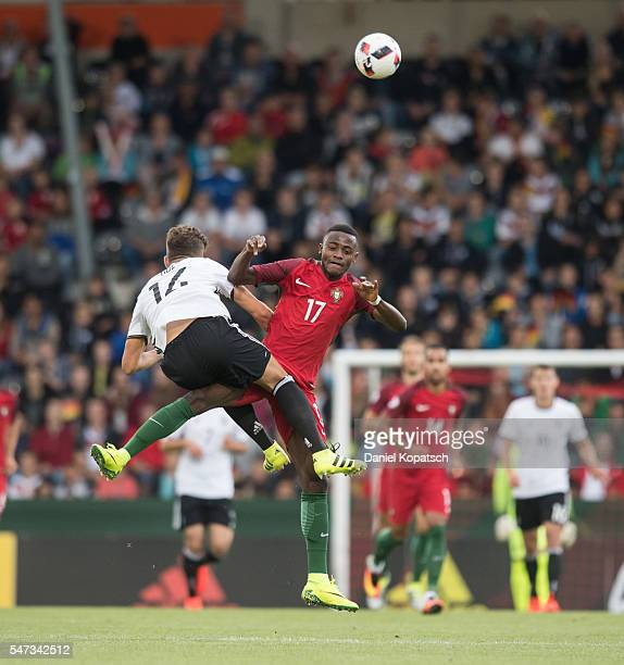 Goekhan Guel of Germany jumps for a header with Asumah Ankrah of Portugal during the UEFA Under19 European Championship match between U19 Germany and...