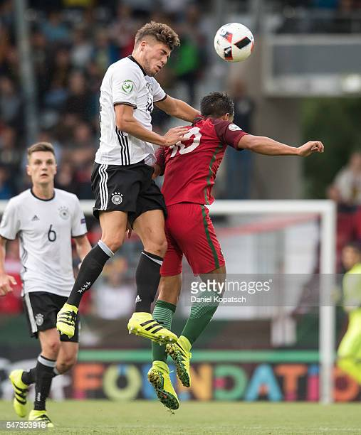 Goekhan Guel of Germany jumps for a header with Joao Carvalho of Portugal during the UEFA Under19 European Championship match between U19 Germany and...