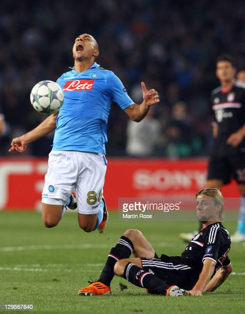 Goekhan Inler of Naples and Anatoliy Tymoshchuk of Muenchen battle for the ball during the UEFA Champions League group A match between SSC Napoli and...