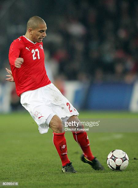 Goekhan Inler of Switzerland runs with the ball during the international friendly match between Switzerland and Germany at the St. Jakob-Park on...