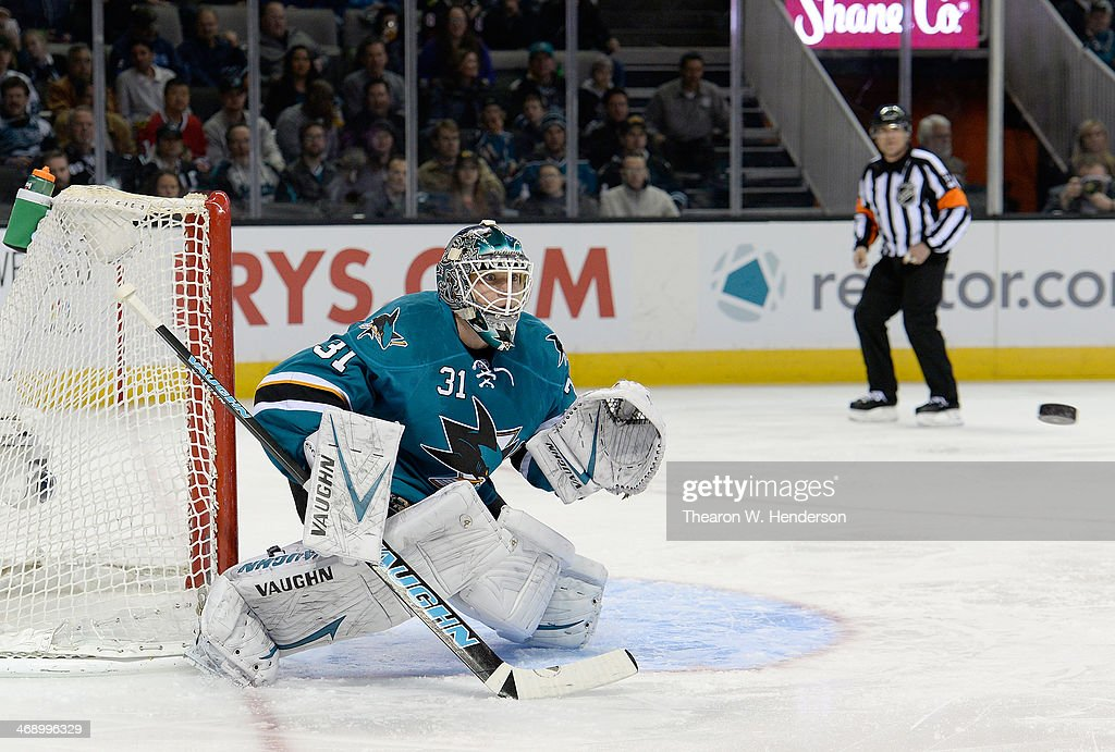 Goelkeeper Antti Niemi #31 of the San Jose Sharks makes a glove hand save against the Chicago Blackhawks during the first period at SAP Center on February 1, 2014 in San Jose, California.