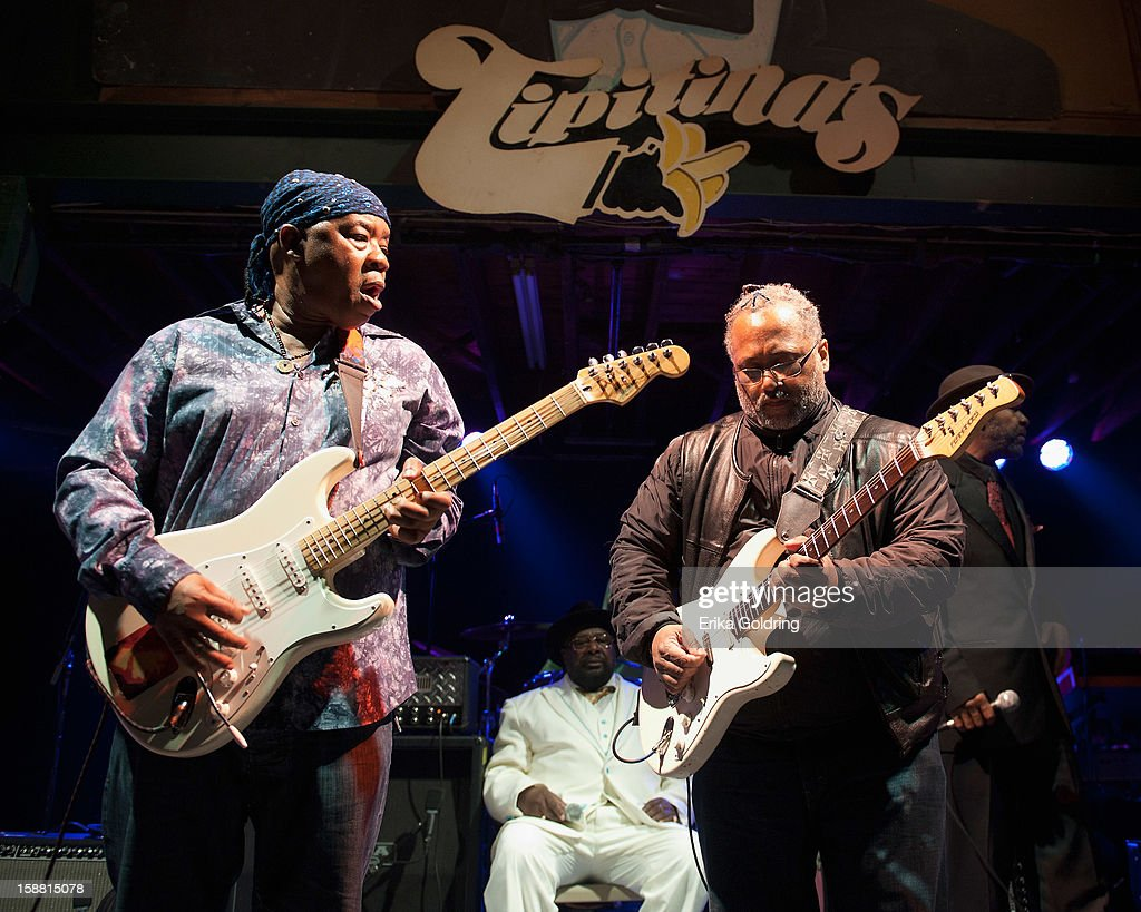 Goerge Clinton (C) and Michael Hampton (R) of George Clinton and Parliament Funkadelic perform at Tipitina's on December 29, 2012 in New Orleans, Louisiana.
