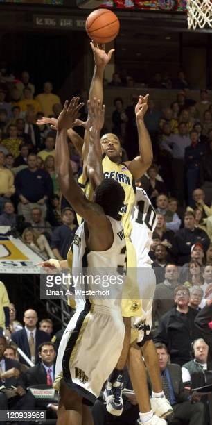 Goergia Tech's BJ Elder shoots from the baseline over Wake Forest's Eric Williams and Jamaal Levy during second half action at the LJVM Coliseum in...