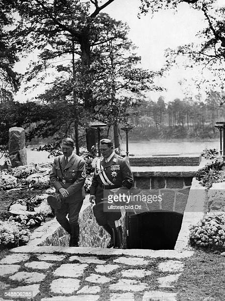 Goering Hermann Politician NSDAP Germany *12011893 Hermann Goering and Adolf Hitler leaving the mausoleum of Goerings first wife Carin near Carinhall...