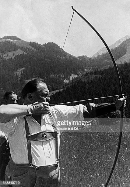 Goering, Hermann - Politician, NSDAP, Germany*12.01.1893-+Goering in lederhosen doing arching in a mountain scenery - undated- Photographer:...
