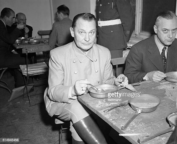Goering Lunches at Trial Nuremberg Germany Hermann Goering seems startled by the photographer's flash as he lunches a la American Army during the...