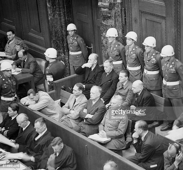 Goering Worries at Trial. Nuremberg, Germany: Worried Herman Goering leans forward on the rail of the dock and gnaws his fingernail during the trials...