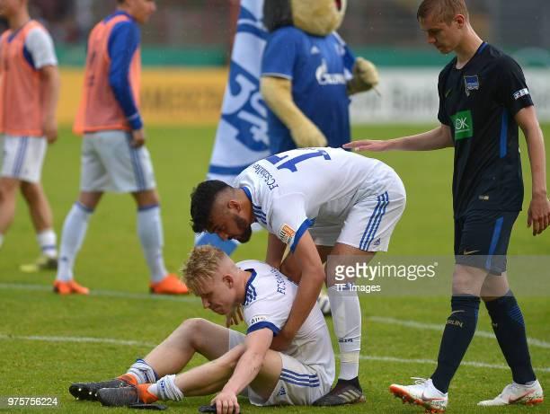 Goerkem Can of Schalke helps Lennart Czyborra of Schalke after the German A Juniors Championship final match between FC Schalke 04 U19 and Hertha BSC...