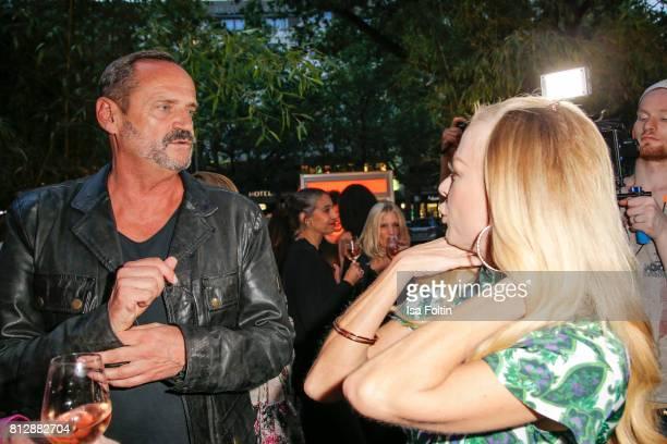 Goetz Elbertzhagen and German actress Jenny Elvers during the 'True Berlin' Hosted By Shan Rahimkhan on July 11 2017 in Berlin Germany