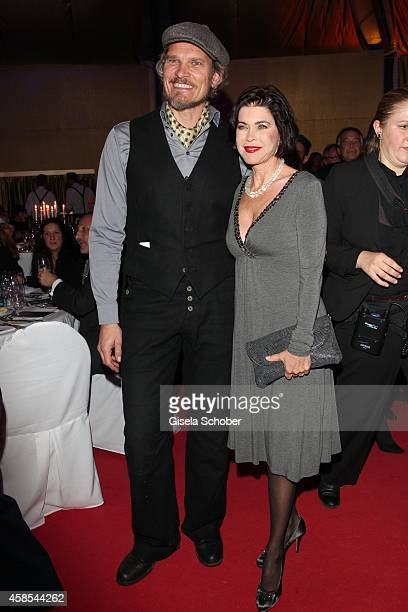Goetz Otto and anja Kruse attend the Cotton Club Dinnershow Premiere at Ungerer Bad on November 6 2014 in Munich Germany