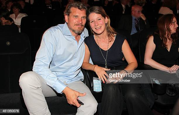 Goetz Otto and his wife Sabine attend the opening night of the Munich Film Festival at Mathaeser Filmpalast on June 27 2014 in Munich Germany