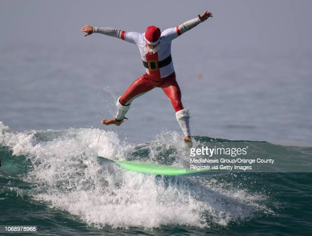 Goff Stepien gets some air as he competes in the yule loggers longboard division during the Surfing Santa event in Dana Point on Saturday November 17...