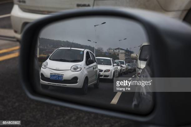 Gofun car on the road on March 182017 in Wuhan Hubei province China The mostly electric share cars are ready for Chinese users in minutes once they...