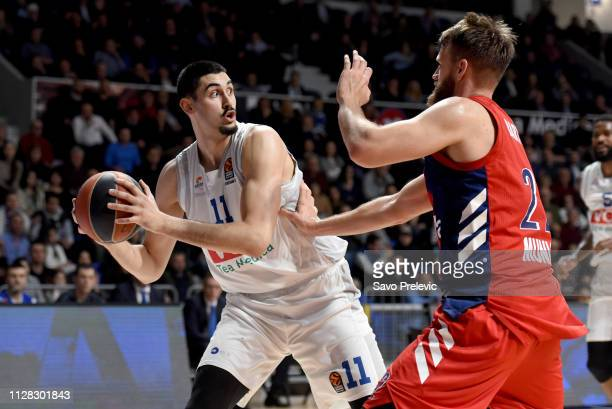 Goga Bitadze #11 of Buducnost Voli Podgorica competes with Danilo Barthel #22 of FC Bayern Munich in action during the 2018/2019 Turkish Airlines...