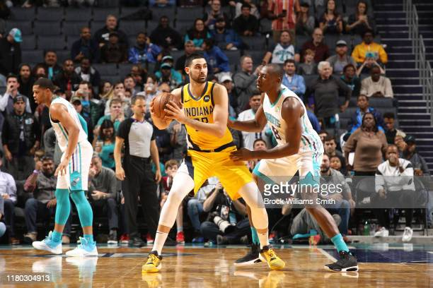 Goga Bitadze of the Indiana Pacers handles the ball against the Charlotte Hornets on November 5 2019 at Spectrum Center in Charlotte North Carolina...