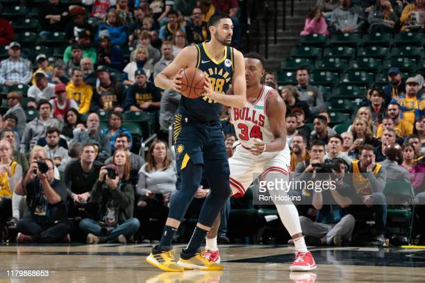 Goga Bitadze of the Indiana Pacers handles the ball against Wendell Carter Jr #34 of the Chicago Bulls on November 3 2019 at Bankers Life Fieldhouse...
