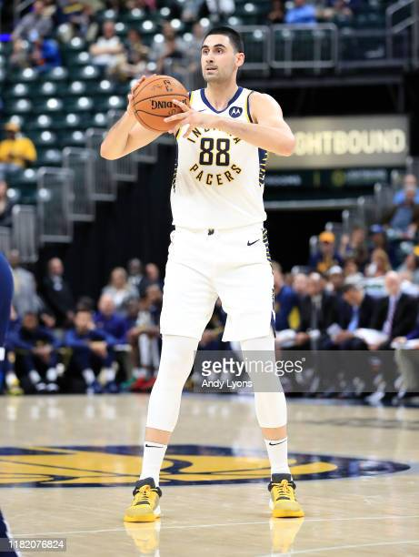 Goga Bitadze of the Indiana Pacers looks to pass the ball against the Minnesota Timberwolves at Bankers Life Fieldhouse on October 15 2019 in...