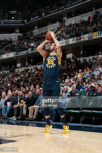 Goga Bitadze of the Indiana Pacers shoots a threepointer against the Washington Wizards on November 6 2019 at Bankers Life Fieldhouse in Indianapolis...