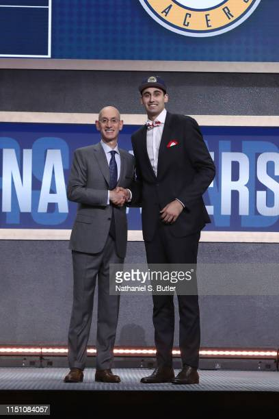 Goga Bitadze shakes hands with NBA Commissioner Adam Silver after being selected number eighteen overall by the Indiana Pacers during the 2019 NBA...