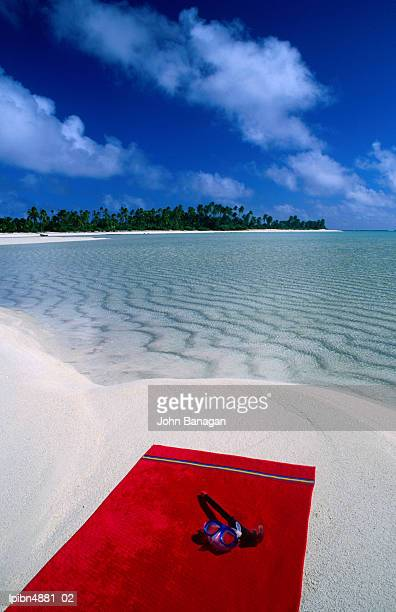 Goggles and towel on idyllic beach and lagoon, Aitutaki, Southern Group, Cook Islands, Pacific