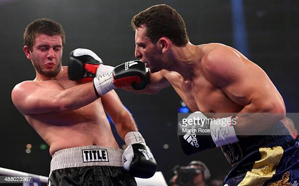 Gogita Gorgiladze of Georgia exchange punches with Noel Gevor of Germany during their super middle weight championship fight at Velodrom on May 3...