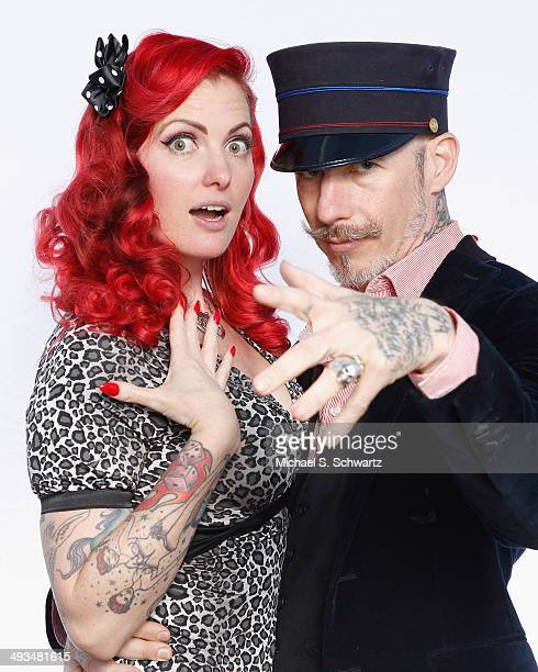 GoGo Amy and Christopher Wonder pose during their attendance at The Ice House Comedy Club on May 23 2014 in Pasadena California