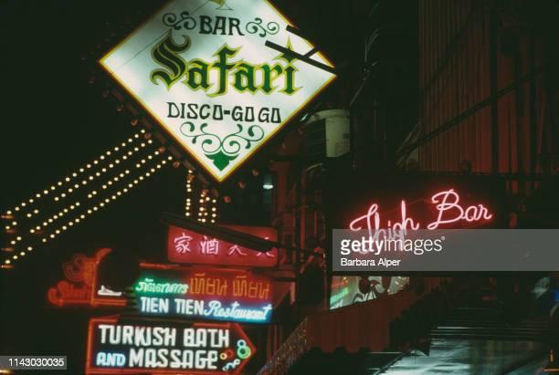 Gogo bars neon signs in Patpong Bangkok Thailand February 1988