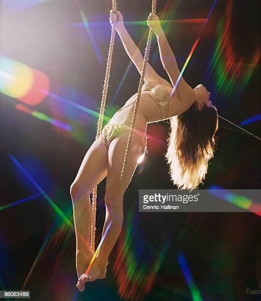 go-go dancer on swing - gogo danseuse photos et images de collection