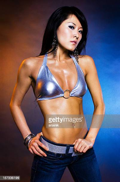 gogo dancer - asian six pack stock photos and pictures