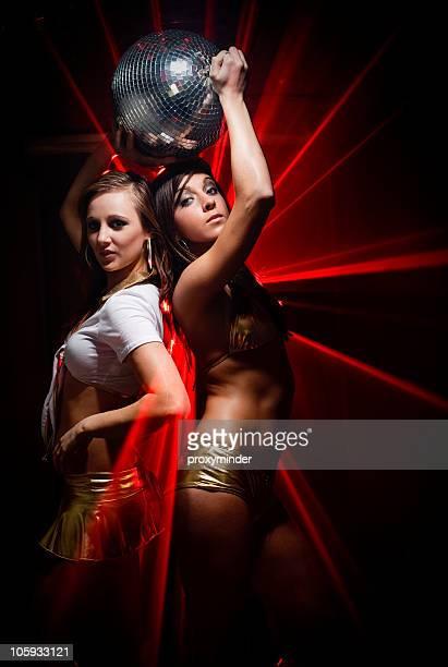 Gogo dancers in laser light