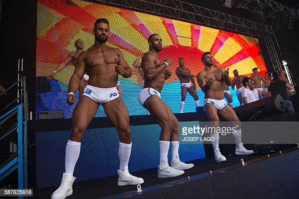Gogo dancers perform during the Circuit Festival's Water Park Day an open air gay party in Vilassar de Mar near Barcelona on August 9 2016 / AFP /...