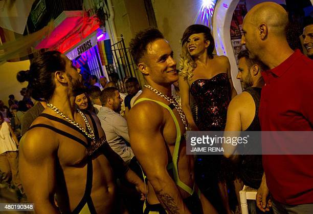 Gogo dancers promote a disco in a tourist street in the city of Ibiza on July 9 2015 AFP PHOTO / JAIME REINA