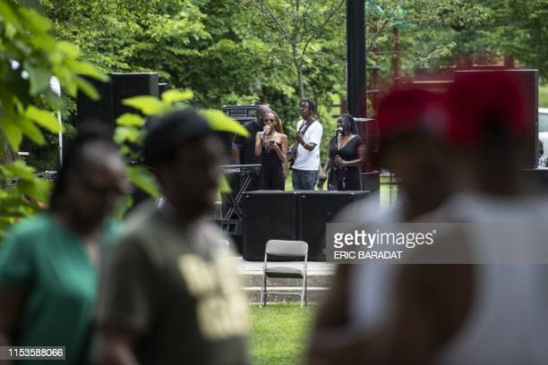 Gogo music fans listen to the band Body of Evidence perform during Summer Peace Jam 2019 at the Marvin Gaye Park in Washington DC on June 29 2019...
