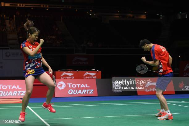 Goh Soon Huat and Shevon Jemie Lai of Malaysia react during their mixed doubles final match against Tontowi Ahmad and Lillyana Natsir of Indonesia at...